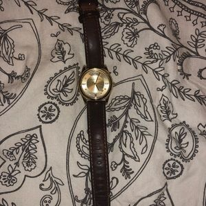 Michael Kors leather strap woman's watch.